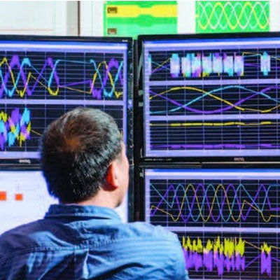 Researcher from the Rensselaer Center for Future Energy Systems (CFES) in front of monitors